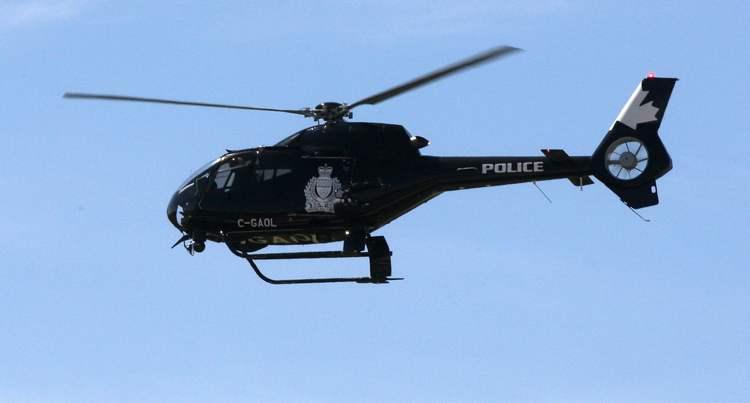 Winnipeg Police helicopter flies over fire scene on Nairne Ave to refuel nearby – July 13,  2011   (JOE BRYKSA / WINNIPEG FREE PRESS)
