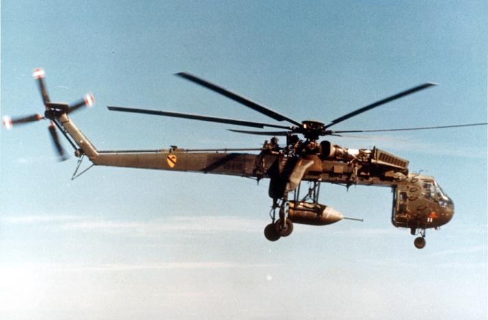 Sikorsky_Skycrane_carrying_parachute_bomb_c