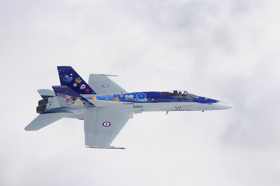 "English/Anglais 409 squadron Demonstration Team pilot, Capt Adam ""Manik"" Runge, in the 2014 Royal Canadian Air Force (RCAF) Canadian Fighter (CF) 188 Hornet demo jet on the 4th of April 2014 at 4 Wing Cold Lake. .  This years' demonstration jet marks 2 milestones for the RCAF. It is the 60th anniversary of 4 Wing, Cold Lake, and the 90th anniversary of the RCAF.  The jet paint scheme was designed by Mr. Jim Belliveau, and unveiled at a ceremony in 409 squadron on the 27th of March.  Photo: Cpl Stuparyk, Image Data Systems (IDS), AETE AE2014-086-02"