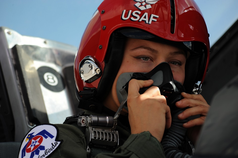 Mixed martial artist champion, Ronda Rousey, adjusts her flight mask in preparation for her Thunderbird F-16 Fighting Falcon flight at Nellis Air Force Base, Nev., Nov. 9, 2012. (U.S. Air Force photo/Staff Sgt. Larry E. Reid Jr., Released)