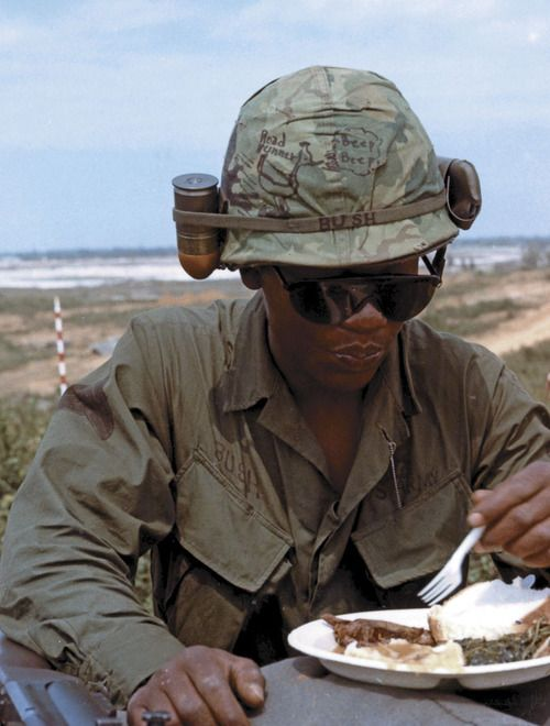 Perhaps hoping the luck of a coyote-evading cartoon character (beep beep!) will rub off, an infantryman bedecks his helmet with the Roadrunner and an M406 grenade (SP4 James B. Egan/U.S. Army/National Archives).
