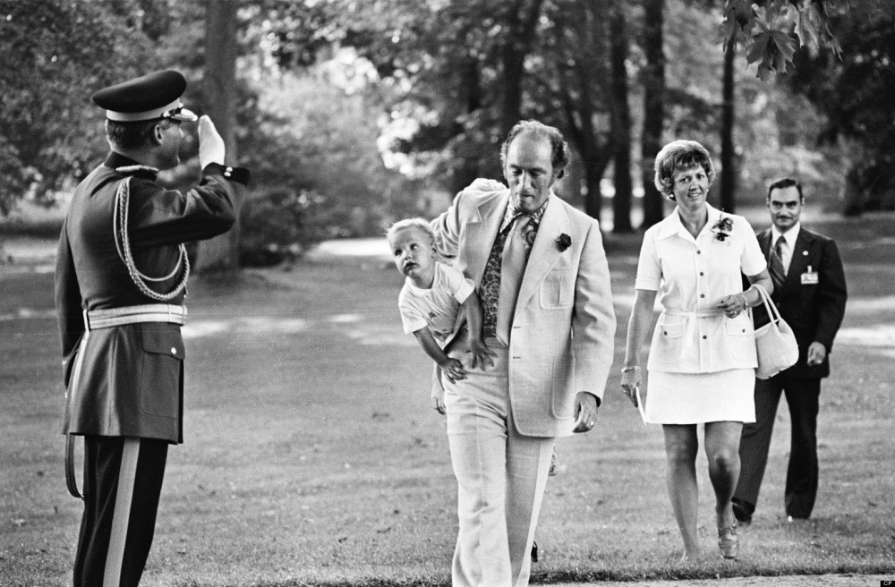 Puerre Trudeau is saluted by RCMP Officer as he carries son Justin to Rideau Hall in 1973 to attend an outdoor reception for visiting heads of the Commonwealth countries in Ottawa.The Canadian Press/ Peter Bregg Peter Bregg/CP