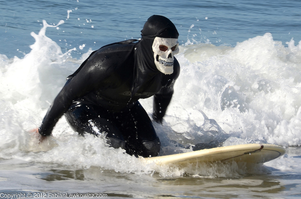 Surfers compete in ZJ Boarding House's 4rth Annual Haunted Heats Halloween Surf Contest at Santa Monica beach on Saturday, October 27, 2012.
