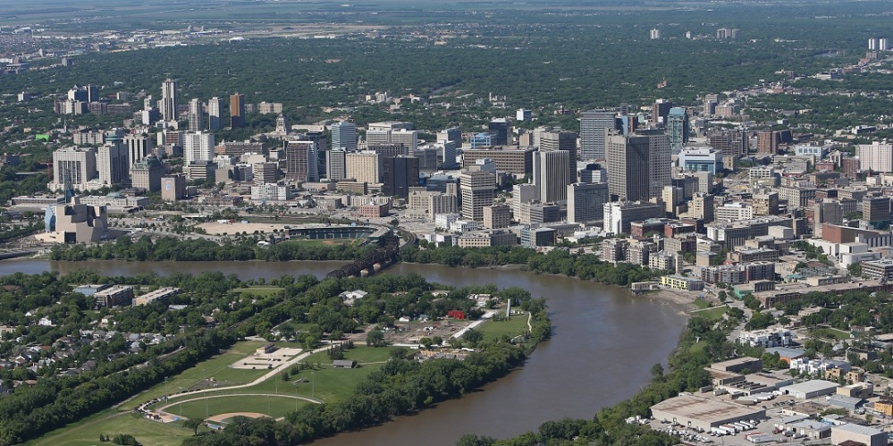 WINNIPEG, MB - JUNE 15: An aerial view of the Winnipeg skyline by the Red River on June 15, 2013 in Winnipeg, Manitoba. (Photo by Tom Szczerbowski/Getty Images)