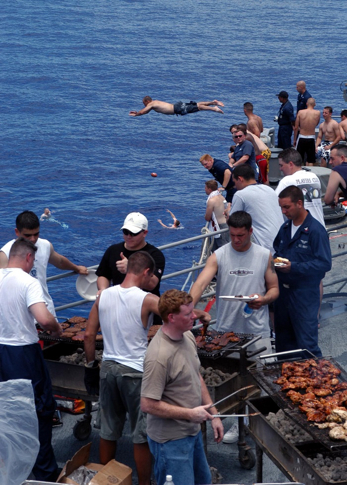 030608-N-7902K-024 Philippine Sea (Jun. 08, 2003) -- Sailors aboard the guided missile cruiser USS Antietam (CG 54) enjoy a swim call and a steal beach picnic in the warm waters of the Western Pacific. Steel beach picnics give Sailors a day to relax and have fun after being out to sea for extended periods of time. Antietam is part of the USS Carl Vinson (CVN 70) Strike Force on deployment in the Western Pacific Ocean. U.S. Navy photo by Photographer's Mate 2nd Class Jeremie Kerns. (RELEASED)