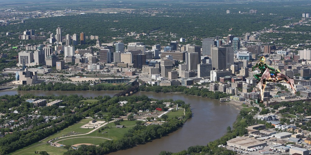 WINNIPEG, MB - JUNE 15: An aerial view of the Winnipeg skyline is seen from above with the Red River in the foreground on June 15, 2013 in Winnipeg, Manitoba. (Photo by Tom Szczerbowski/Getty Images) *** Local Caption ***