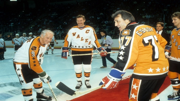 HARTFORD, CT - FEBRUARY 4:  Honorary captains Goride Howe and Phil Esposito pose for the opening face-off as Larry Robinson #19 of the Wales Conference and the Montreal Canadiens and Wayne Gretzky #99 of the Campbell Conference and the Edmonton Oilers look on before the 1986 38th NHL All-Star Game against the Wales Conference on February 4, 1986 at the Hartford Civic Center in Hartford, Connecticut. The Wales Conference defeated the Campbell Conference 4-3. (Photo by B Bennett/Getty Images)