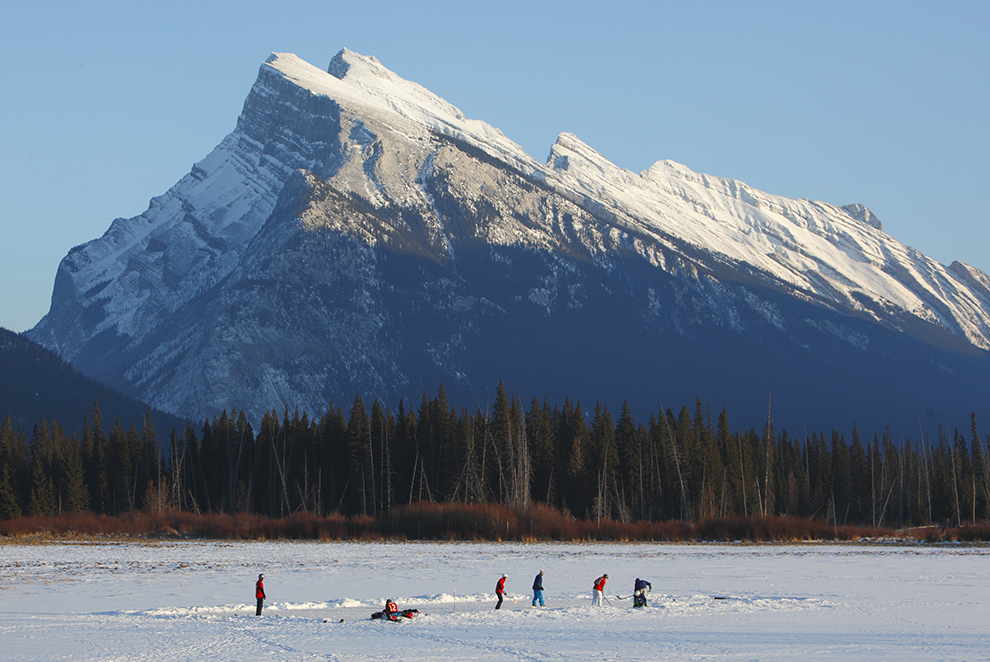 Playing winter hockey in Banff National Park, Alberta, Canada