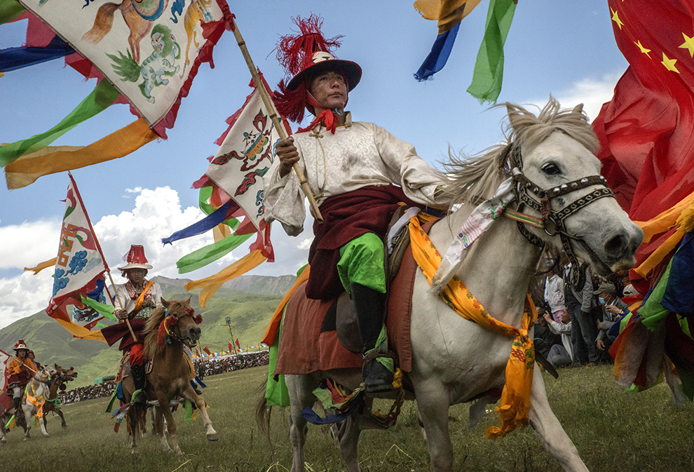 Tibetan horsemen display their skills at a government-organized horse festival in Yushu, China, July 26, 2015. These days, horse festivals on the Tibetan plateau are not just about equestrian prowess, but political affairs with a propaganda goal ? to signal that traditional Tibetan culture is thriving, contrary to what the Dalai Lama and other critics say. (Gilles Sabrie/The New York Times)