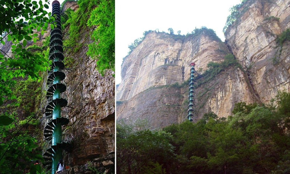 """STAIRWAY TO HEAVEN From the bottom, it looks like the real life stairway to heaven. But tourism official in central China are hoping the 300ft high spiral staircase will give their visitor numbers a lift. The stairs were installed beside the Taihang Mountains, in Linzhou, Henan province, to give tourists an authentic feel for the high life. """"Here the wind blows and batters them, the birds fly past them, the stairs creak. It is a lot more authentic than an elevator,"""" explained one official. But they admit that the stairs aren't for everyone - and ask visitors to sign forms saying they have no heart or lung problems and are aged under 60. """"If you got half way up and couldn't go any further, you might just have to stay there,"""" joked one."""