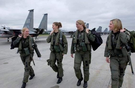 """ELMENDORF AFB, Alaska -- Four F-15C pilots from the 3rd Wing step to their respective jets July 5 for the fini flight of Maj. Andrea """"Gunna"""" Misener, 19th Figher Squadron, pictured far left. To her right are Capt. Jammie """"Trix"""" Jamieson of the 12th Fighter Squadron, Maj. Carey """"Mamba"""" Jones, 19th Fighter Squadron, and Capt. Samantha """"Combo"""" Weeks, 12th Fighter Squadron. When Maj. Misener worked out who would be joining her in her four-ship fini flight, it became apparent there was a probable first in the Eagle community. Despite the growing number of females who have joined the ranks of fighter pilots since the career opened up to women in 1993, an all-female four-ship had not been accomplished in the F-15C before. """"It was a great flight,"""" said Maj. Misener after her final flight at Elmendorf. """"We killed all the bandits and protected the target area. There were no Eagle losses."""" The major says she will miss her flying squadron, as she moves on to new challenges at the year-long Joint Military Intelligence College in Washington D.C. (photo by Tech. Sgt. Keith Brown)"""