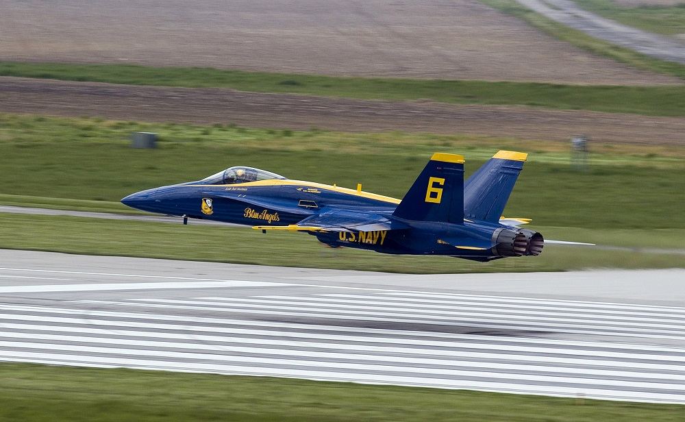 050522-N-7559C-001 Springfield, Ill. (May 22, 2005) - The Blue Angels opposing solo performs a low transition on take off during their air show in Springfield. The Blue Angels perform more than 70 shows at 34 different locations throughout the country each year. U.S. Navy photo by PhotographerÕs Mate 2nd Class Ryan Courtade (RELEASED)