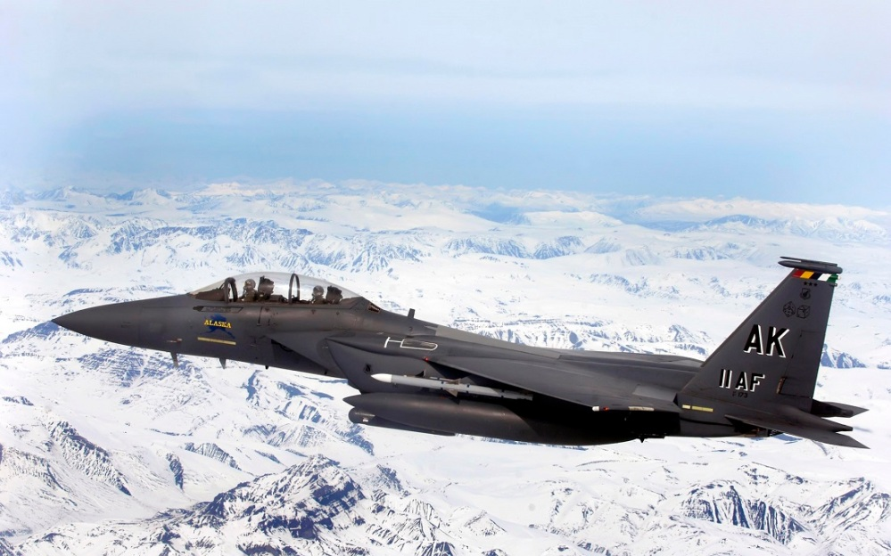 An F-15E Strike Eagle flys over glacial fields during a training mission April 20 over Alaska. The F-15E is assigned to the 90th Fighter Squadron at Elmendorf Air Force Base, Alaska, which traces its history back to August 1917. The F-15E at Elmendorf AFB will soon be replaced by the F-22 Raptor. (U.S. Air Force photo/Tech. Sgt. Keith Brown)