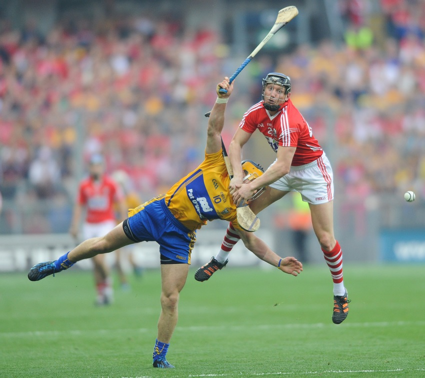 John Conlon of Clare in action against Stephan White of Cork during the All-Ireland senior hurling final replay at Croke park. Photograph by John Kelly.
