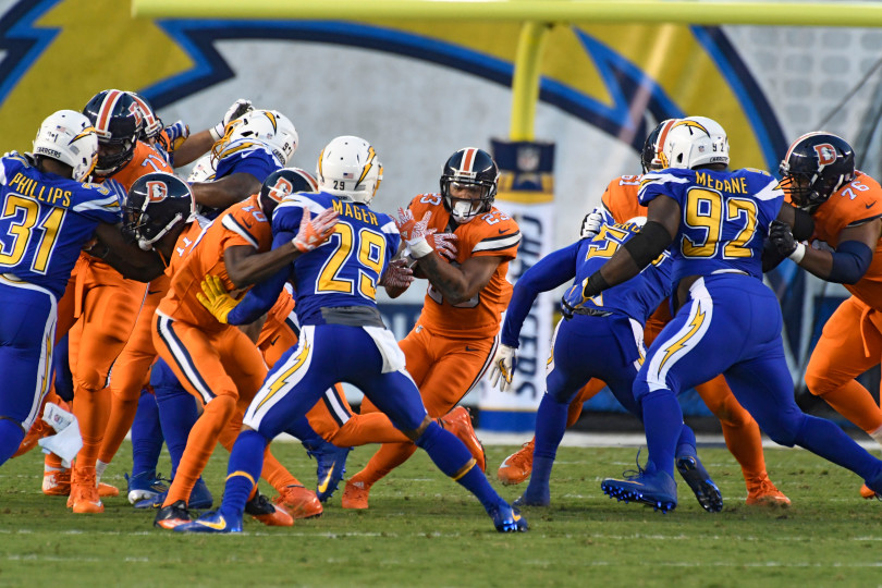 Denver Broncos running back Devontae Booker (23) finds a hole in the San Diego Chargers defense for a short gain during the second quarter October 13, 2016 at Qualcomm Stadium in San Diego, Calif. John Leyba, The Denver Post