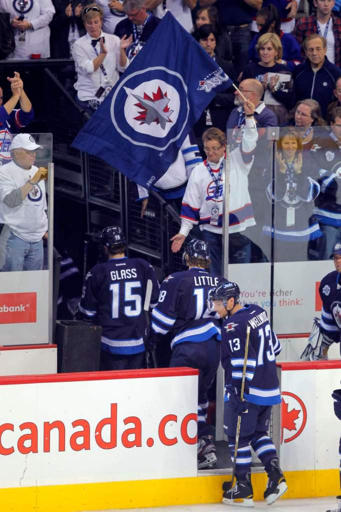 First Jets game - Winnipeg - Winnipeg Jets vs. Montreal Canadians. Players leave the ice after a 5-1 loss.  Oct. 9, 2011 (BORIS MINKEVICH / WINNIPEG FREE PRESS)