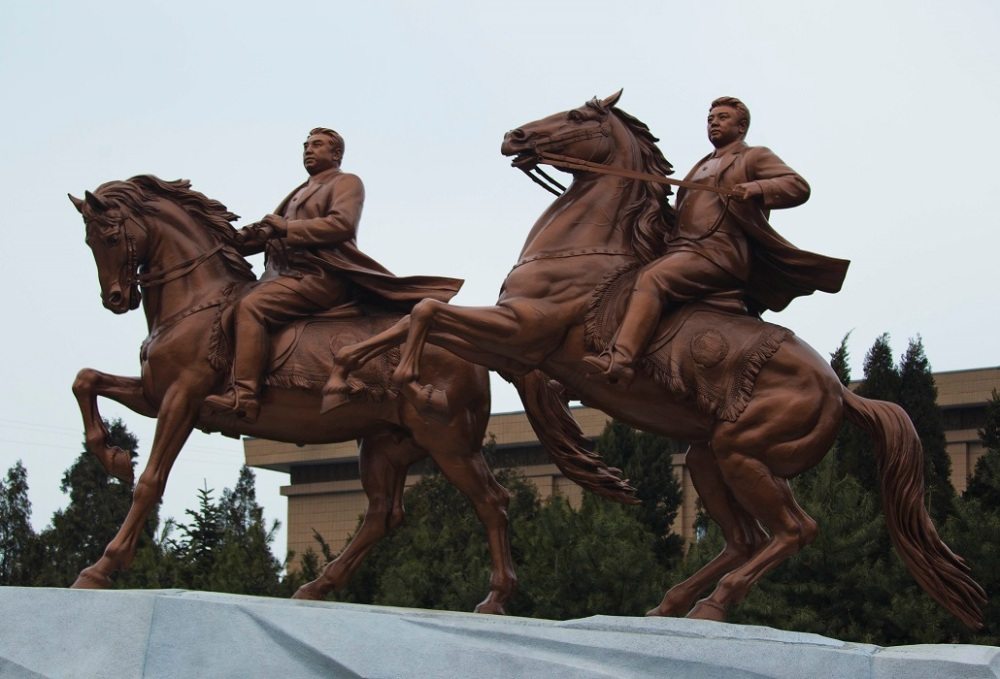 A new bronze statue depicting the late North Korean leader Kim Jong Il, right, and his father Kim Il Sung are seen at stands inside the grounds of the Mansudae Art Studio after it was unveiled in Pyongyang Tuesday, Feb. 14, 2012. As North Koreans prepare for what would have been the 70th birthday of late leader Kim Jong Il this week, the country's state media have gone to great lengths to build up the man who led the nation for 17 years until his death in December. (AP Photo/David Guttenfelder)