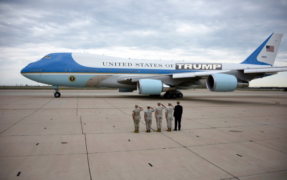 Marines salute as President Barack Obama leaves in Air Force One from Marine Corps Air Station Miramar in San Diego Monday, Oct. 12, 2015. (AP Photo/Denis Poroy)