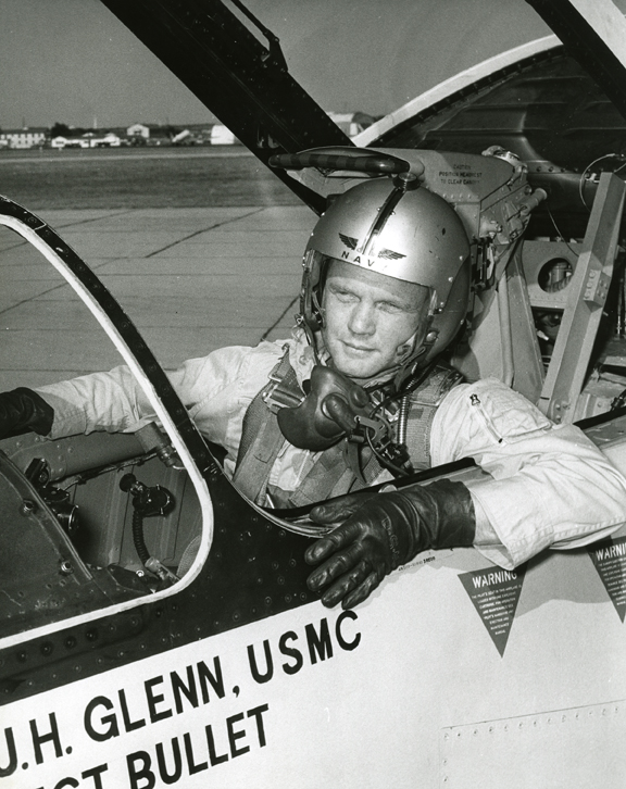 "Photograph of John Glenn in the cockpit his F8U-1P Crusader during the ""Project Bullet"" record breaking transcontinental flight, 1957"