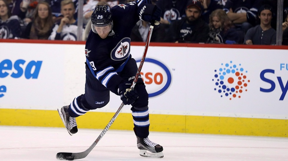 Winnipeg Jets' Patrik Laine (29) fires a shot against the Edmonton Oilers' during second period pre-season NHL hockey in Winnipeg, Friday, September 30, 2016. THE CANADIAN PRESS/Trevor Hagan