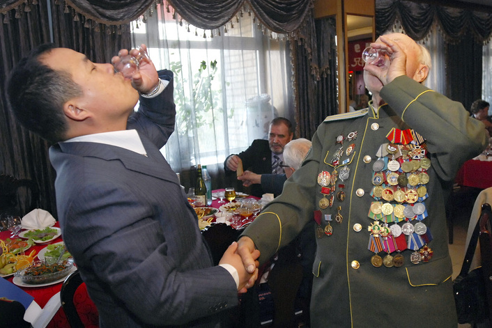 A Russian World War II veteran and a Chinese businessman drink a toast to mark the upcoming Victory Day, in a Chinese restaurant in Vladivostok, Russia's Far Eastern port about 9,300 kilometers (some 5,750 miles) east of Moscow, Wednesday, May 6, 2009. Chinese businessmen invited Russian World War II veterans to celebrate the anniversary of the World War II victory in a Chinese restaurant. Russia celebrates the anniversary of the allied victory over Nazi Germany on May 9. (AP Photo)